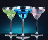 Cocktails on dark color background — Stock Photo