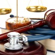 Medicine law concept. Gavel, scales and stethoscope on book close up — Stock Photo