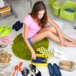 Beautiful girl chooses shoes in room — ストック写真