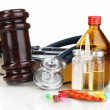 Stock Photo: Medicine law concept. Gavel and pills isolated on white