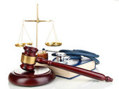 Medicine law concept. Gavel, scales and stethoscope on book isolated on white — Stock Photo