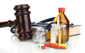Medicine law concept. Gavel and pills isolated on white — Stock Photo