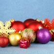 Christmas decorations on blue background — Stock Photo