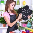 Beautiful girl florist with flowers in flowers shop — Foto Stock