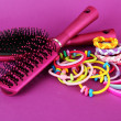 Scrunchies, hairbrush and hair - clip on pink background — Stock Photo #30116401