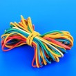 Stock Photo: Colorful rubber bands on blue background