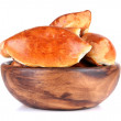 Fresh baked pasties in wooden bowl, isolated on white — Stock Photo