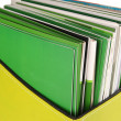Stock Photo: Magazines and folders in green box, isolated on white