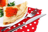 Delicious pancakes with red caviar isolated on white — Stock Photo