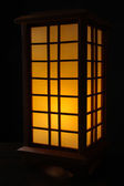 Japanese table lamp on black background — Stock Photo