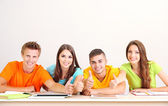 Group of young students sitting in the room — ストック写真