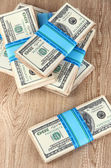 Stacks of money on wooden table — Stock Photo