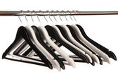 Black and white clothes hangers isolated on white — Stock Photo