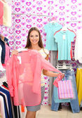 Beautiful young woman in shop — Stock Photo