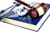 Medicine law concept. Gavel and stethoscope on book close up — Stock Photo
