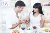 Man proposing engagement ring his woman over restaurant table — Stock Photo