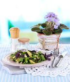 Light salad on plate on table on room background — Stock Photo
