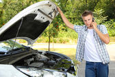 Man calling repair service after car breakdown — Stock Photo