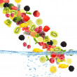 Flight of fruits and berries in water — Stock Photo