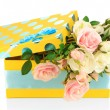 Yellow gift box with flowers isolated on white — Stock Photo