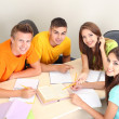 Group of young students sitting in the room — Foto de Stock