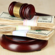 Stock Photo: Stacks of money and judges gavel on wooden table