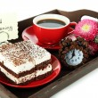 Cup of tea with cakes on wooden tray isolated on white — Stockfoto