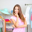Stock Photo: Beautiful young womin walk-in closet