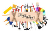 "Many different tools for construction and home with inscription ""Overhaul"" isolated on white — Stock Photo"