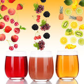 Flight of fruits and berries in glass of juice on yellow background — Stock Photo