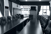 Interior of empty conference room in shades of grey — Stock Photo