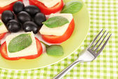 Cheese mozzarella with vegetables in plate on table — Stock Photo