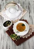 Cup of tea with linden on napkins on wooden table — 图库照片