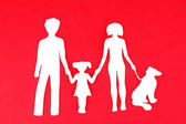 Family from paper on bright background — Stockfoto
