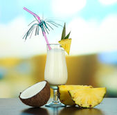Pina colada drink in cocktail glass, on bright background — Stock Photo