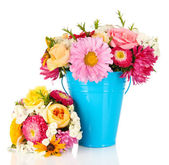 Beautiful bouquet of bright flowers in color vase, isolated on white — Stock Photo