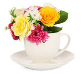 Beautiful bouquet of bright flowers in color mug, isolated on white — Stock Photo