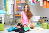 Beautiful girl chooses clothes in walk-in closet — Stock Photo