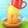 Three cups on bright background — Stock Photo