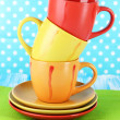 Three cups on bright background — Stock Photo #30247049