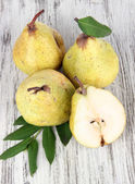 Pears on wooden background — Stock Photo