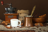 Metal turk and coffee cup on dark background — Stock Photo