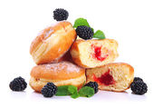 Tasty donuts with berries, isolated on white — Stock Photo