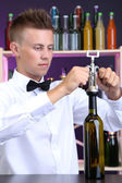 Bartender opens bottle of wine — Stock Photo