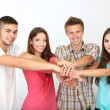 Group of happy beautiful young people at room — Stock Photo #30312429