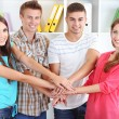Group of happy beautiful young people at room — Stock Photo #30312477