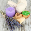 Stock Photo: Still life with lavender candle, soap, massage balls, soap and fresh lavender, on wooden background