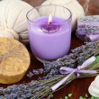 Stock Photo: Still life with lavender candle, soap, massage balls, bottles, soap and fresh lavender, on wooden table on wooden background