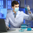 Young laboratory scientist working at lab — Stock Photo