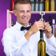 Bartender opens bottle of wine — Stock Photo #30313123